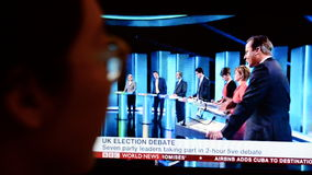 UK Election TV Debate. A viewer watches election live TV debate on a computer monitor on April 2, 2015 in London, UK. The UK goes to the polls on May 7 in the Stock Images