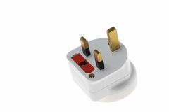 UK electric plug. On white background stock photography