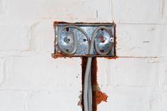 UK Electrical installation. Of a socket into a wall of a house Stock Photography