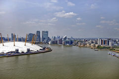 UK, England, London, 02 Arena and Canary Wharf Skyline Stock Image