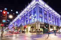 Uk, England, London - 2014 November 13: Oxford street shops Chri. Stmas illumination lights decorated New Year Stock Photo