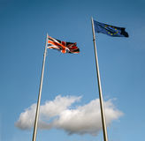 UK and EU flags in the clouds stock photography