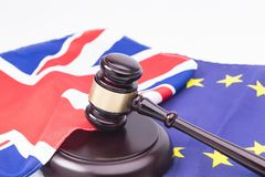 UK EU legal concept. Brexit UK EU legal concept, different position theme with wooden judge gavels on table and flags royalty free stock images
