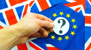 UK EU referendum. Referendum concept with hand holding question mark against EU and UK flags Stock Images