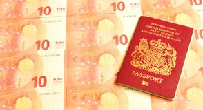 UK in euro zone. Concept with British passport and euro banknotes Royalty Free Stock Images