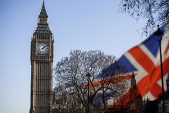 UK flag and Big Ben. British union jack flag and Big Ben Clock Tower and Parliament house at city of Westminster in the background - UK votes to leave the EU Stock Images