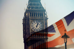 UK flag and Big Ben. British union jack flag and Big Ben Clock Tower and Parliament house at city of Westminster in the background - UK votes to leave the EU Royalty Free Stock Photo