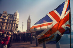 UK flag and Big Ben. British union jack flag and Big Ben Clock Tower and Parliament house at city of Westminster in the background - UK votes to leave the EU Stock Photography