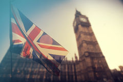 UK flag and Big Ben. British union jack flag and Big Ben Clock Tower and Parliament house at city of Westminster in the background - UK votes to leave the EU Royalty Free Stock Photography