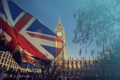 UK flag and Big Ben. British union jack flag and Big Ben Clock Tower and Parliament house at city of Westminster in the background - UK votes to leave the EU Stock Image