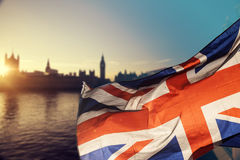 UK flag and Big Ben. British union jack flag and Big Ben Clock Tower and Parliament house at city of Westminster in the background - UK votes to leave the EU Royalty Free Stock Photos