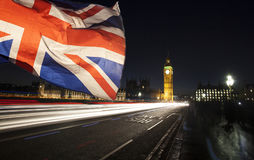 UK flag and Big Ben. British union jack flag and Big Ben Clock Tower and Parliament house at city of Westminster in the background - UK votes to leave the EU Royalty Free Stock Image