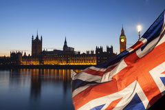 UK flag and Big Ben. British union jack flag and Big Ben Clock Tower and Parliament house at city of Westminster in the background - UK votes to leave the EU Royalty Free Stock Images