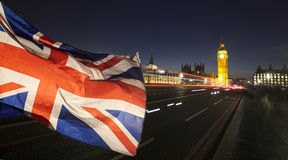 UK flag and Big Ben. British union jack flag and Big Ben Clock Tower and Parliament house at city of Westminster in the background - UK votes to leave the EU Stock Photo