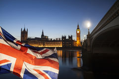 UK flag and Big Ben. British union jack flag and Big Ben Clock Tower and Parliament house at city of Westminster in the background - UK votes to leave the EU Stock Photos