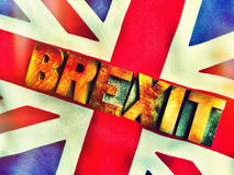 UK flag with Brexit word in wood type filtered Stock Photos