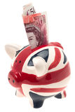 UK flag china piggy bank with banknote Stock Image