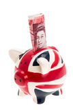 UK flag china piggy bank with banknote Royalty Free Stock Photography