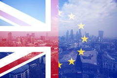 UK flag, EU flag and financial buildings Royalty Free Stock Photo