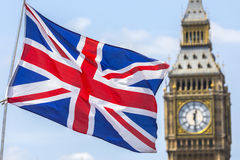 UK Flag and the Houses of Parliament Royalty Free Stock Photography