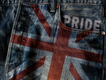 UK flag On Jeans Denim Texture with pride word. Closeup of Unite stock image