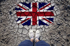 Uk flag with man on cracked soil Stock Images