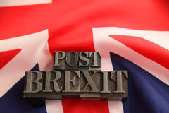UK flag with metal post Brexit words Royalty Free Stock Photo