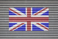 UK Flag On Metal Shutter. UK Metal Shutter. United Kingdom Union Jack flag on metal roller shutter door Royalty Free Stock Images