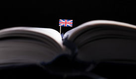 UK flag in the middle of the book. Knowledge and education conce Royalty Free Stock Images