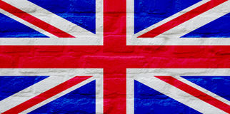 UK Flag over brick wall. Union Jack national flag of United Kingdom painted over brick wall background Stock Photography