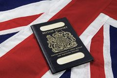 UK Flag and passport. An old style united Kingdom passport on a Union Jack background Royalty Free Stock Image