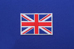 Uk flag patch on fabric Royalty Free Stock Image