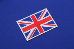 Uk flag patch on fabric Stock Photos