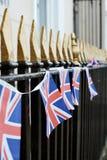 UK flag on railings. Bristish flag bunting on iron railings Royalty Free Stock Photos