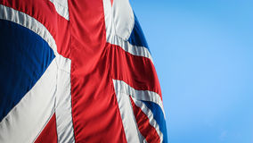 UK flag. The UK Union flag, often referred to as The Union Jack, flying against a blue sky Stock Images