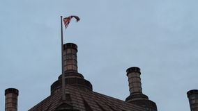 UK Flag waving. Waving UK flag on top of a building stock video footage
