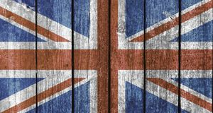 UK flag wood texture. National flag of the United Kingdom on a wood deck texture stock photos
