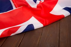 UK flag on wooden background.The place to advertise, template.Relations between States. stock photos