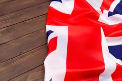 UK flag on wooden background top view.The place to advertise, te. UK flag on wooden background.The place to advertise, template. Relations between States Stock Image