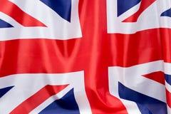UK-flaggan fladdrar i vinden Stället som ska annonseras, mall royaltyfri fotografi