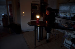 2014 UK Floods Chertsey England. UK Chertsey -- 20 Feb 2014 -- Ron Luckhurst, 68, lights a gas powered lamp at dusk in his home still surrounded by floodwaters Royalty Free Stock Images