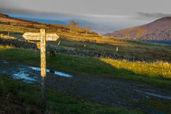 UK footpath finger post catching sun Stock Photography