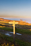 UK footpath finger post catching sun Royalty Free Stock Photo