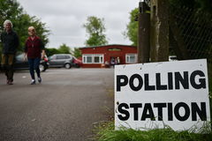 UK General Election. Melksham, UK - June 8, 2017: Members of the public caste their votes at a polling station located in a village hall. Polling stations have Stock Photos