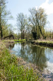 UK habitats river course. UK habitats natural river course with associated trees and marginals Stock Photo