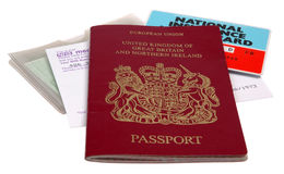 UK Identification papers. Passport, medical card, driving license, NI card, isolated on white background