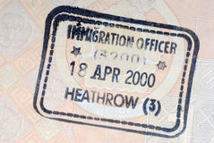 UK immigration arrival passport stamp. United Kingdom immigration entry stamp on the inside page of a passport stock photo