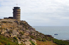 UK, Jersey Island. UK, Jersey, German WWII watch tower and bunker at La Corbiere now used as transmitting station stock photography