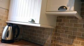 UK Kitchen Units. White kitchen in small UK Home unitdetail stock images