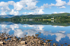 UK Lake District Ullswater Cumbria England with mountains and blue sky reflections summer Royalty Free Stock Photography
